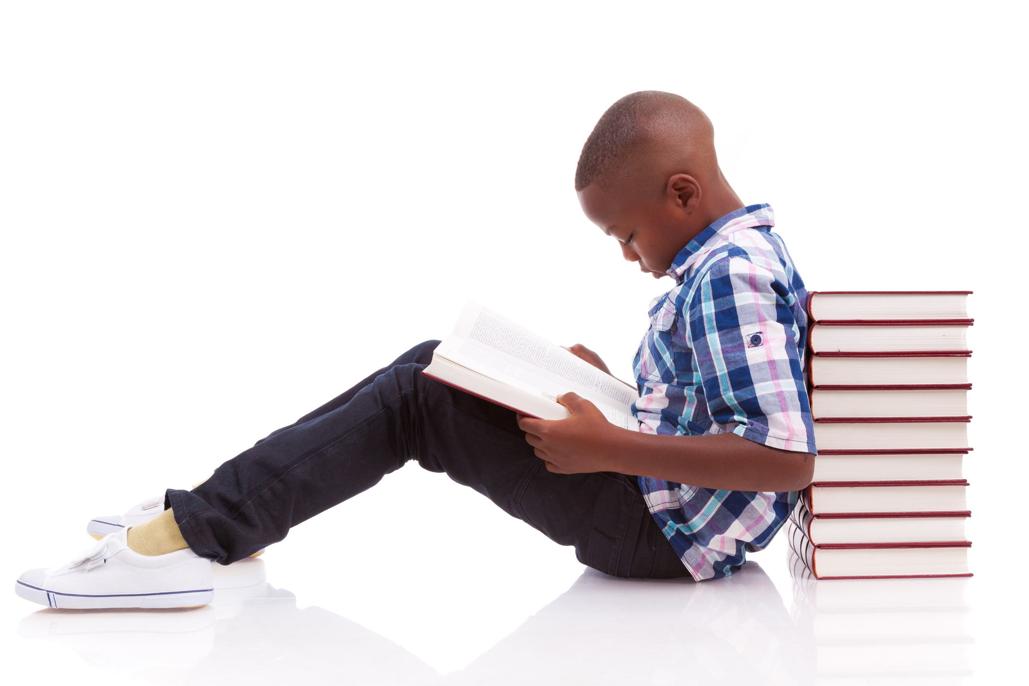 African American school boy reading a book